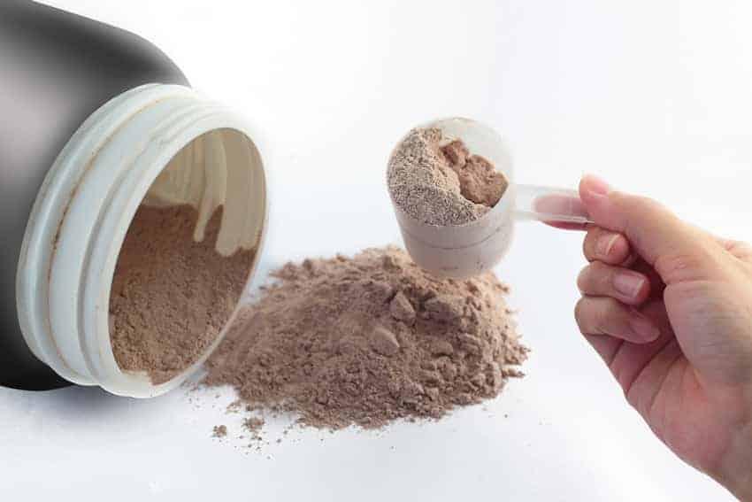 Hand-holding-Protein-Powder-scoop